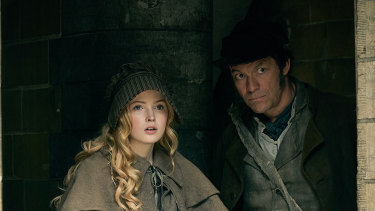 Ellie Bamber as Cosette and Dominic West as Jean Valjean.