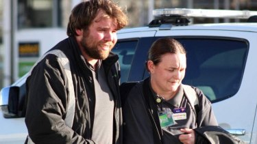 Workers make their way to safety after a suspected stabbing in Dunedin.