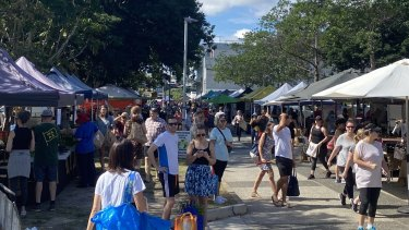 Shoppers at Jan Powers Farmers Market at the Brisbane Powerhouse on Saturday ignore the social-distancing requirements.