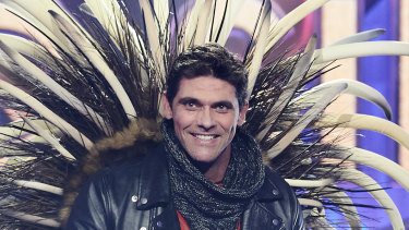 Former tennis star Mark Philippoussis is unmasked on The Masked Singer Australia.