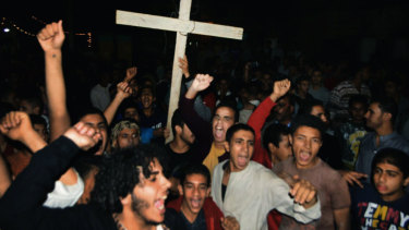 Coptic Christians chant slogans during a protest following the Islamic State attack.