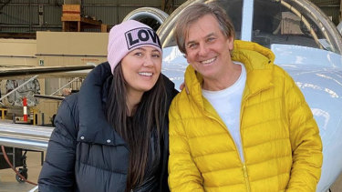 Andrew Norbury (right), widely known as the husband of Real Housewives of Melbourne star Lydia Schiavello (left), in front of the same kind of jet at issue in the lawsuit.