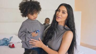 Kim Kardashian juggles motherhood with minding Kanye West.