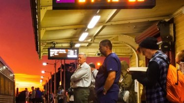 Commuters waiting at Gisborne station for a V/Line train from Bendigo. New longer new trains are too long for the platforms at some older stations.