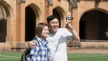 A group of Chinese people take a tour of the main quadrangle at Sydney University. Australia will become more Asian over time, says Malaysia's Prime Minister.