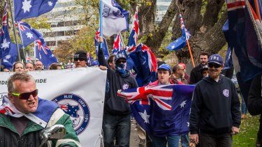 The right-wing group True Blue Crew  marching on the streets of Melbourne during an Australia Pride March  in 2017.