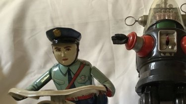 Vintage toys, such as this Robbie the Robot, circa 1950s, and Tim Plate battery operated motorcycle from the 1960s can attract hefty prices.