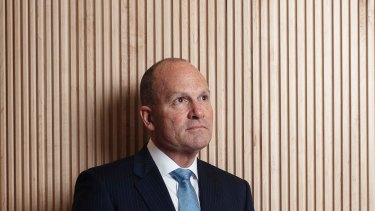 IAG chief executive Peter Harmer reports a 59.6 per cent fall in net profit after tax for the year.
