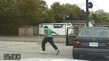 An image taken from a police dash camera shows Walter Scott running from his vehicle just before he was shot and killed by a policeman in South Carolina in April.