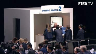 Lowy casts his vote in the voting booth.