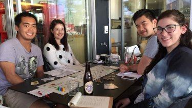 Board game enthusiasts Joshua Teo, Katie Wright, Jared Toe and Samantha Burns were still at Club Sosay fours hours after it opened.