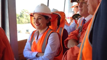 Transport Minister Jackie Trad watches rail being laid at the new Murrumba Downs station.