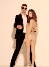 Emily Ratajkowski appeared wearing only a g-string with singer Robin Thicke in the video for his song Blurred Lines.