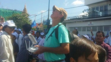 In this photo from Cambodian website Fresh News, Australian filmmaker James Ricketson is seen apparently operating a drone.