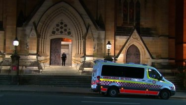 An ambulance waits outside St Mary's Cathedral to take the bell-ringer to hospital.