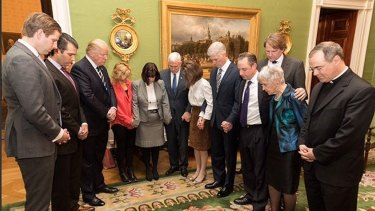 President Trump, third from left, prays with members of his family, his inner circle and Father Paul Scalia, son of late Judge Antonin Scalia after the nomination of Neil Gorsuch, fifth from right, to the Supreme Court.
