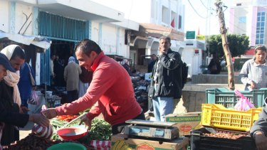 Abdessalam Bouazizi says he and other street vendors are still harassed and extorted by the police.