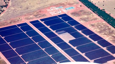Australia's largest solar power plant gets the last of its 1,366,380 panels.