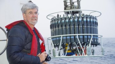 Church on the CSIRO research voyage in May. The instruments behind him collect water samples and other information.