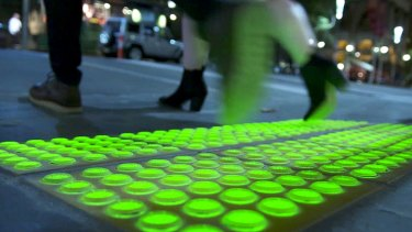 The new safety lights have been built into the footpath on the corner of Little Collins and Swanston streets.