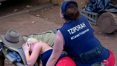 Team work:  Keira Macguire cries after a run-in with Steve Price as Tziporah Malkah comforts her.
