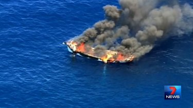 Channel 7 image of a boat on fire off the Gold Coast.