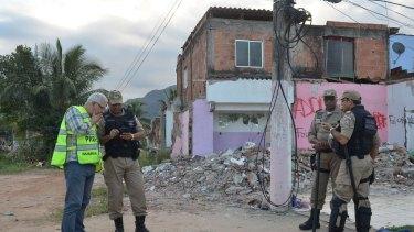 Civil police during the eviction campaign at Vila Autodromo, Barra da Tijuca.