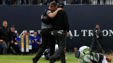 Iconic: Stenson and Mickelson embrace as they leave the Royal Troon course.