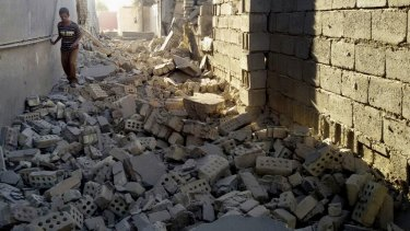 A man walks in the rubble of a damaged house in Fallujah. The city's 100,000 remaining inhabitants will fear a repeat of the liberation of Ramadi, which has reportedly left that city in ruins.
