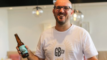 Good Beer Co. founder James Grugeon with a bottle of Great Barrier Beer.