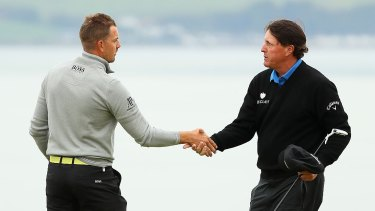 Prizefighters: Henrik Stenson and Phil Mickelson shake hands after their duel in the British Open.