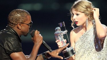 Kanye West takes the microphone from Taylor Swift as she accepted a VMA in 2009.