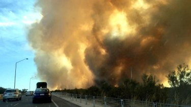 The fire gets close to the freeway near Mundijong Road.