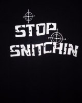 Stop snitching T-shirt logo with crosshairs and bullet holes.