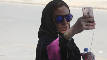 Saudi activist Ghada Ghazzawi tapes a selfie video marking a historical day for Saudi women as she arrives to vote for the municipal elections on December 12, 2015 in Jeddah, Saudi Arabia.