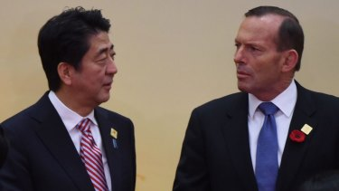 Defence purchases discussed: Prime Minister Tony Abbott chats with Japanese Prime Minister Shinzo Abe at the East Asia Summit in Myanmar.