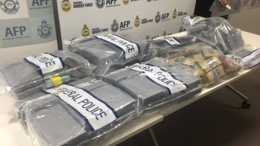 Cocaine and cash seized by police in a joint operation.