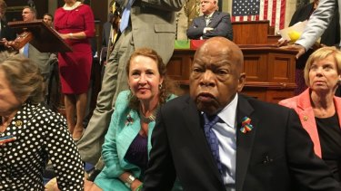 Democrat members of Congress including Representative John Lewis, centre, and Elizabeth Esty participate in a sit-in earlier this month to demand gun control legislation.
