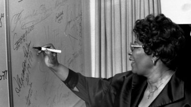 Ella Fitzgerald signs her name at the Opera House.