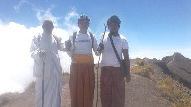 Three of the four men who climbed to the summit of Mount Agung on Friday. Jero Mangku Ada, behind the camera, said he was asked by the gods to make an offering.