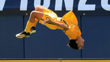 Sam Kerr performs her trademark backflip after  scoring a goal against Japan at the Tournament of Nations.