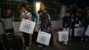 The second group of refugees to be accepted for resettlement in the US has left Port Moresby for the United States this morning. They are pictured here leaving the Port Moresby hotel early this morning.