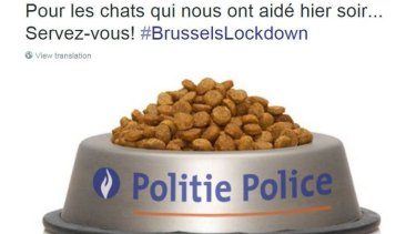"""The picture tweeted by police after Brussels residents heeded pleas not to post or share information about the raids. It reads: """"For the cats who helped us last night ... Help yourselves!"""""""