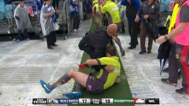 Helping hand: Darren Alchin hits the ground while trying to avoid projectiles.