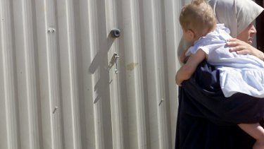 Children are being born and spending extended periods of time in detention, the Ombudsman has warned.