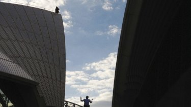 High drama on the House: Police escorted a man who climbed onto the Opera House back to ground level on Sunday.