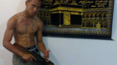 This Facebook photo of Fahim Awang holding an AK-47 is about six to eight years old, according to Sheikh Faizel Gaffoor.