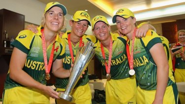 Jess Cameron (far right) celebrates with  Elyse Villani, Julie Hunter and Meg Lanning  with the Women's World Twenty20 trophy in 2014.