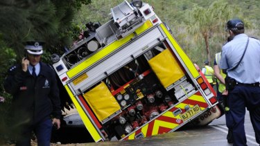 Ageing infrastructure: A fire truck sinks into a hole after a water main burst at Bilgola in Sydney's north.