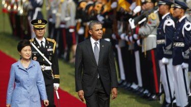 Barack Obama and Park Geun-hye inspect an honour guard at a welcoming ceremony at the presidential Blue House in Seoul.